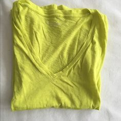 J CREW Factory. Neon yellow shirt. XXS J crew factory, neon yellow/green shirt. Size XXS but could fit up to a medium comfortably. Perfect condition J.Crew Factory Tops Tees - Short Sleeve