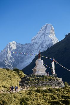 Trails to Everest are adorned with colorful prayer flags and dotted with sacred stupas. Mount Everest Base Camp, Everest Base Camp Trek, Nepal Trekking, World Geography, Places Of Interest, Places To See, Adventure Travel, Tourism, Trail