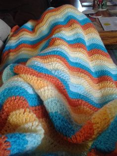 Summer Ripple using Stylecraft Special DK in spice, saffron, lemon, cloud blue, and turquoise