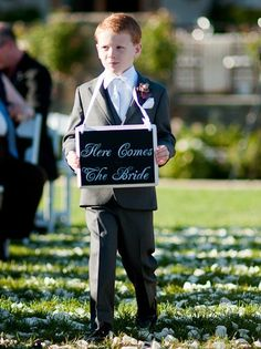 Wedding Sign Wedding PHOTO PROP Here Comes The Bride for the Flower Girl or Ring Bearer to CARRY. $37.95, via Etsy.
