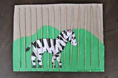 Zoo art activity - child makes a picture and then they sew the bars of the zoo cage.  Good fine motor activity.
