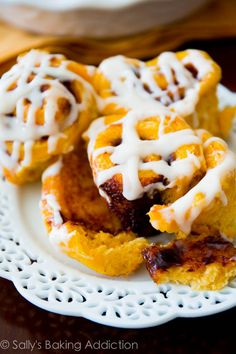 Soft Pumpkin Cinnamon Rolls filled with a gooey cinnamon swirl and maple cream cheese icing.