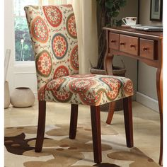 This set of two Suzani parson dining chairs is constructed on a solid mid-tone brown, solid wood frame complemented by a transitional design on fabric that will add a pop of color to your home.
