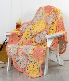Twirling Garden Throw - Even in the spring and summer, a cotton throw will be used for comfort. This pretty spiraling crochet square is perfect in light shades to add a fresh spot of color to your décor.