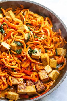 Spiralized Sweet Potato Noodles with Crispy Tofu and Thai Coconut Curry Sauce (Vegan, Gluten Free, One Pan). This vegetarian meal is perfect for meal prep, or easy weeknight dinner. Spiralizer Recipes, Tofu Recipes, Curry Recipes, Vegetarian Recipes, Dinner Recipes, Vegan Meals, Delicious Recipes, Dessert Recipes, Rezepte