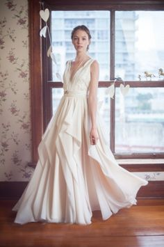 Flowy feminine wedding dress by Truvelle, (Vancouver, BC)