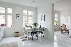A serene white and grey Swedish apartment