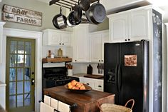 Our Vintage Home Love: like the door in kitchen to laundry idea