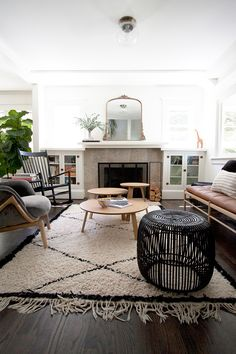 Moroccan rug in living room with dark floors, wood accents, rattan and more