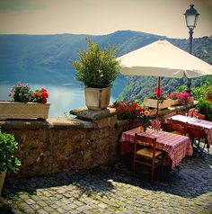 Lago Albano, Italy. How lovely, but would that slanted table annoy me?