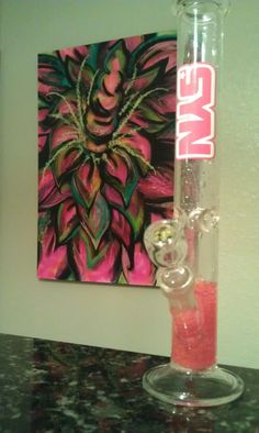 Pink diffuser beads in a pink Syn Glass straight tube.   Haha it's so similar to ours! I love the beads