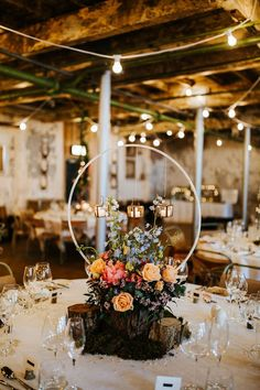 Industrial Mill Wedding with Spectacular Florals & Feathers Floral hoop / boho wedding decor / boho wedding florals / floral hoop / floral wedding centrepieces Wedding Table Centerpieces, Wedding Flower Arrangements, Flower Centerpieces, Reception Decorations, Centerpiece Ideas, Wedding Receptions, Wedding Ceremony, Indoor Wedding Decorations, Fall Wedding