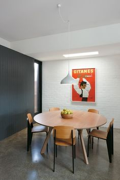 Melbourne-based AM. Architecture have designed the Nth Fitzroy House. Architecture The owners approached us with a common question. Is it feasible to extend a semi-detached dwelling on a narrow site? The benefit this property. Dining Table Pendant Light, Lights Over Dining Table, Dining Table Lighting, Pendant Lamp, Pendant Lights, Kitchen Lighting, House Furniture Design, House Design, Melbourne