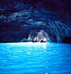 Places to go! The Blue Grotto (Italian: Grotta Azzurra) is a sea cave on the coast of the island of Capri, southern Italy. Sunlight, passing through an underwater cavity and shining through the seawater, creates a blue reflection that illuminates the cavern. The cave extends some 50 metres into the cliff at the surface, and is about 150 metres deep, with a sandy bottom.[1]