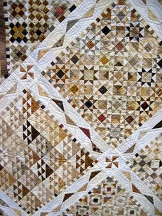 Love all the tiny pieces - this is like 4 small quilts assembled into one larger one