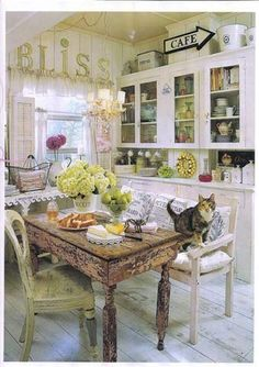 I love the table and shelves, but I can imagine soft sunshine yellow walls. I've always wanted a yellow kitchen.
