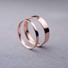 Smooth, simple rose gold wedding bands. By Lily Emme.   http://emmalinebride.com/planning/rose-gold-wedding-ideas/ #GoldJewelleryWedding
