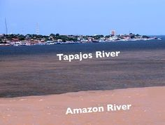 The Meeting of the Waters, Santarem, Brazil. The sediment-rich brown waters of the Amazon meet with the clear blue Tapajos, creating a distinct line between the two as they run side-by-side.