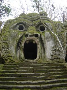 """""""The Sacro Bosco (""""Sacred Grove""""), colloquially called Park of the Monsters (""""Parco dei Mostri"""") is a monumental complex located in Bomarzo, in the province of Viterbo, in northern Lazio, Italy."""" (wikipedia)"""