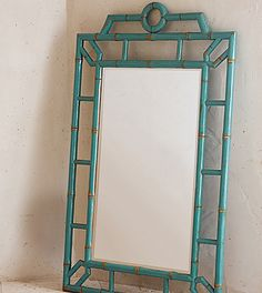 Bungalow Mirror - Hand made of Chinese elm crafted to resemble bamboo, this lacquered turquoise Bungalow Mirror infuses any space with island-getaway glamour. Overall: 29″ W x 2″ D x 46″ H. $595. Buy here.