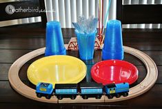 CUTE SET-UP! Then Birthday Boy can keep the train/tracks as an extra gift! :-) Thomas the Train Birthday Party » Heather Bird Photography #Trains
