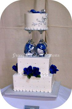 White, Navy Blue and Silver Wedding Cake I love the wine glass idea/silver and blue beads in the glass???