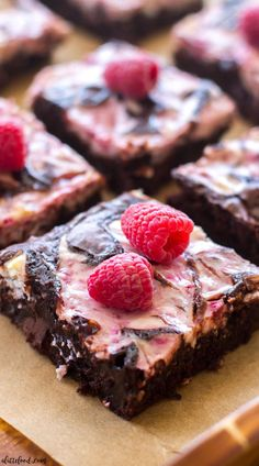 These homemade Raspberry Cheesecake Brownies are rich, fudgy, and full of the best cheesecake flavor! Homemade fudge brownies are swirled with raspberry cheesecake filling, and baked to perfection!