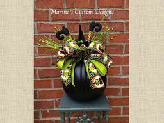 This arrangement is decorated in a black pumpkin vase with lime green picks, a witch hat, witch legs, lime green ribbon, and Halloween ribbon. Halloween Ribbon, Halloween Treats, Fall Halloween, Halloween Decorations, Pumpkin Vase, Witch Legs, Black Pumpkin, Custom Design, Tabletop