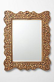 """Tree trunk mirror-Anthropologie:  This inspires a DIY. Use wine works as the frame, stencil/decal a wine glass silhouette in the middle where your mouth would reflect on the mirror and stencil/decal the quote """"Wine about it"""" at the bottom of the mirror!  I'd like it anyway."""