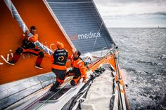 May 21, 2015. Leg 7 to Lisbon onboard Team Alvimedica. Day 04. Nick Dana leaps onto the furled Fractional Code Zero in an attempt to bring it down to windward, while Dave Swete and Seb Marsset pull from below. Arriving at the southwestern corner of the Ice Exclusion Zone the fleet is all within sight and six miles of each other