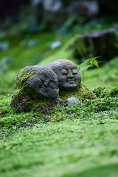 Jizo statues at Ohara Sanzen-in temple, Kyoto, Japan. Jizo statue, usually depicted as a monk with a halo around his shaved head, a staff to force open the gates of hell and a wish-fulfilling jewel to light up the darkness.