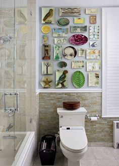 John Derian decoupage plates, in a most unusual setting.  Gorgeous tilework in the bathroom, too.
