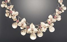 Metal Clay artist Jennifer Smith-Righter created this piece. All flowers are created with the precious metal clay.