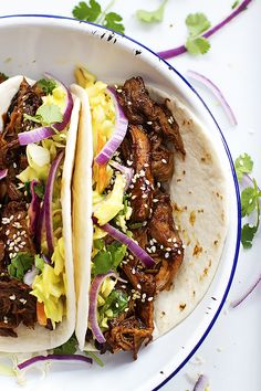 Slow Cooker Korean BBQ Pork Tacos made with Korean BBQ sauce, topped with creamy slaw. From @cremedelacrumb #FrenchsSweetAndSpicy