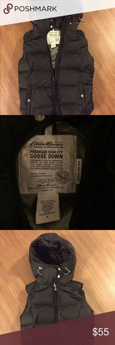 Eddie Bauer premium quality goose down vest Super warm, puffy, adorable black vest with hood and fleece lining. I bought this a couple years ago and haven't had much use of it since moving to Austin. Shell and lining are polyester, and insulation is goose down. Worn only a handful of times, no stains or marks. Eddie Bauer Jackets & Coats Vests