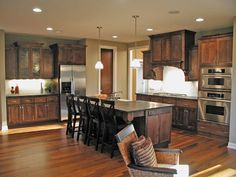 Open kitchen with plenty of counter and cupboard space in this Craftsman style home.  House Plan # 481158.