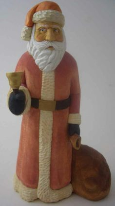 http://joeswoodturning.com/wood%20carving/Santa-with-bell-and-bag-8.jpg