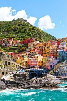 Cinque Terre, Italy - I love this place. I have a large framed print in my entrance hall, love the colours.