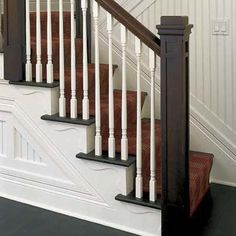 Add trim to stairs........close-up of decorative brackets fastened to the outside of a stair stringer
