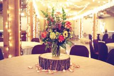 """We are obsessed with the lighting and tree stump centerpieces at this rustic ranch wedding! At The Tatanka Ranch"""