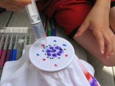 Science craft with permanent markers and alcohol on t-shirts!