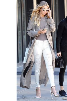 The Model wears J Brand's 620 Mid Rise Super Skinny in Divo while out for lunch in New York.    - HarpersBAZAAR.com