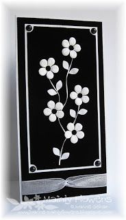 handmade card ... black and white ... black card base with white matting and die cut flowrs ... tall and thin format .. luv the bold graphic look of this card ...