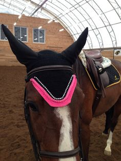 Black horse fly bonnet with hot pink trim and crystals and stretch ears.