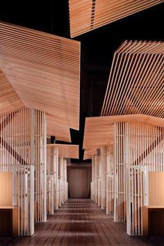 Hokkaido, Japan's Niseko Lookout Cafe features an incredible architectural, wooden-walk through.  See the use of wood in our Rising Barns at Risingbarn.com. #wood #design #architecture #amazing #fantastical #structure #walk #through #hall #illusion #wonder #inspire