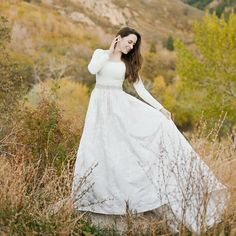 modest wedding dress with long sleeves and a full skirt from alta moda.