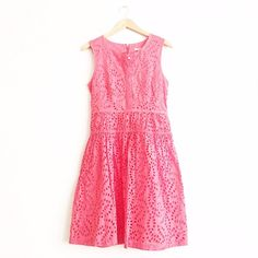 J. Crew Coral Eyelet Dress Retail. Excellent condition. Worn once. Excellent condition with no rips or stains. Selling for my sister, not my size. No try ons. Sleeveless. Zip back. Tag marked through to prevent in store returns. First picture filtered. J. Crew Dresses
