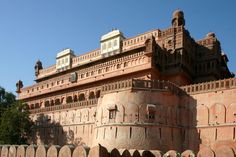 "Front view of Junagarh Fort in the city of Bikaner, Rajasthan, India.  Originally called 'Chintamani' and renamed ""Junagarh  Fort "" when the Royal family moved to Lalgarh Palace outside the fort limits. It is one of the few major forts not built on a hilltop. The modern city of Bikaner has developed around the fort.The fort complex was built under the supervision of Karan Chand, the Prime Minister of Raja Rai Singh, the sixth ruler of Bikaner, who ruled from 1571 to 1611 AD."