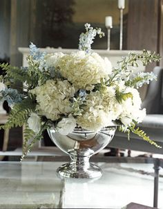 The mercury glass compote holds garden blooms.   - HouseBeautiful.com
