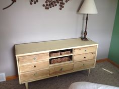 Dresser with Annie Sloan chalk paint (cream) and dark and light wax. New knobs from Hobby Lobby.